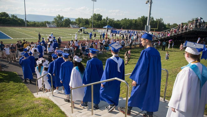 Wallkill High School students walk to their graduation ceremony in June. The graduation rate in New York last year was 90% for white students, 75.3% for black students and 74.5% for Hispanic students.