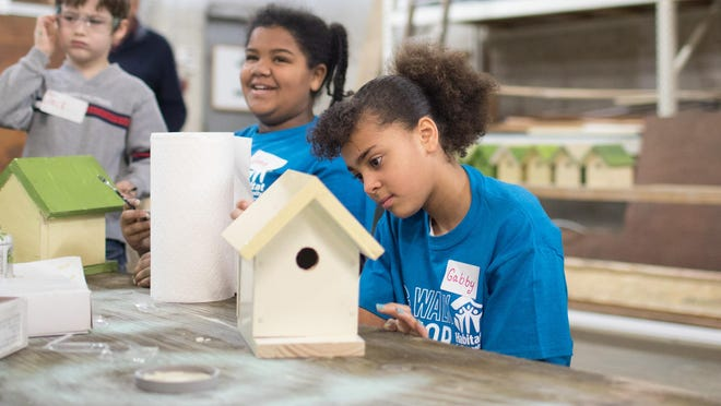 Iyana Lewis, left, and Gabby Spearman build birdhouses during Habitat for Humanity of Greater Newburgh's Martin Luther King Jr day of service on Monday.