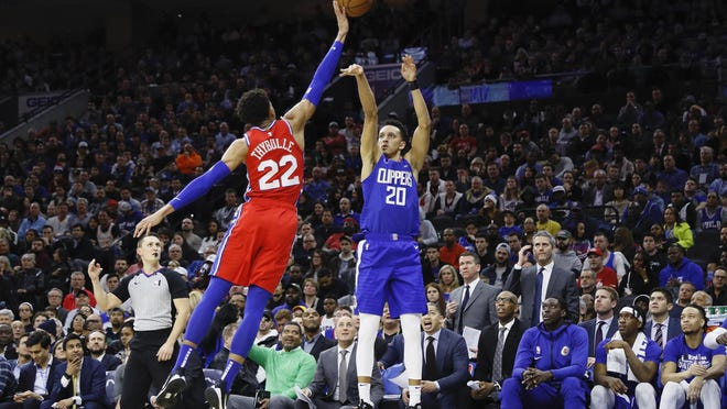 Sixers rookie Matisse Thybulle, left, blocks the shot of the Clippers' Landry Shamet.