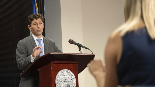 Minneapolis Mayor Jacob Frey answers a reporter's question during a news conference in August.