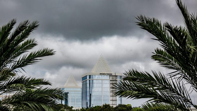 Clouds hover over the DiVosta Towers near the Gardens Mall in October 2019. While his Gun Club Road headquarters are renovated, Palm Beach County Sheriff Ric Bradshaw is spending $35,000 a month to lease executive office space for four years in the Class A office building.