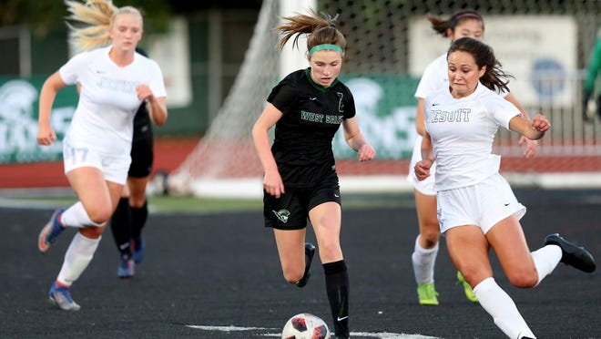 West Salem's Rylee Loewen, center, is bookmarked by Jesuit's Macy Barhyte, left, and Callan Harrington in a Sept. 16 game at West Salem.