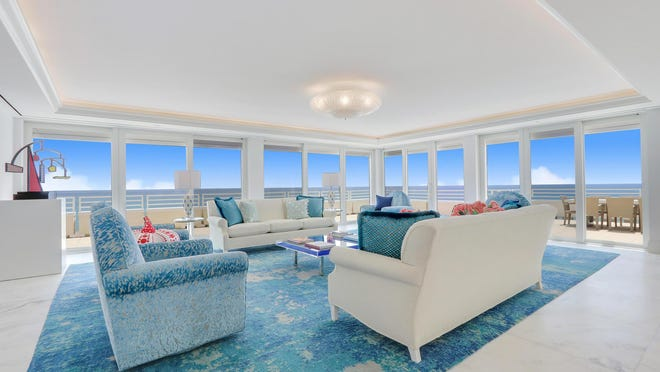 The great room in Penthouse 2 at Sun and Surf, 100 Sunrise Ave., has walls of glass doors that offer extraordinarily wide views of the Atlantic Ocean. The penthouse just sold for a recorded $14 million, a price that ties it with the third-most expensive condo ever to sell in Palm Beach.