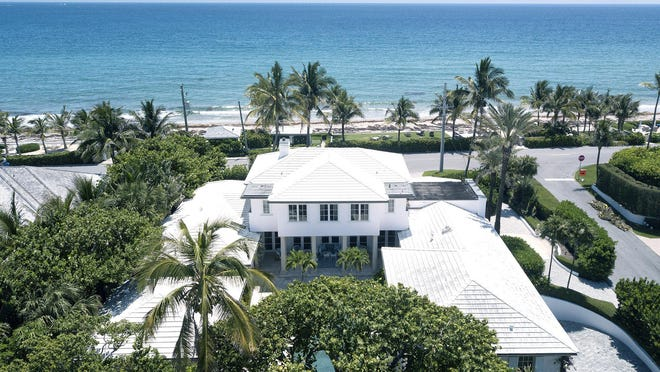 An aerial photo of 101 Nightingale Trail in Palm Beach shows the house's courtyard design and orientation toward the sea. The house just sold for $12.4 million, the price recorded with the deed.