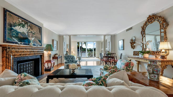 In the living room of No. 2B at The Villas at 425 Worth Ave., furniture is arranged to capture views of the cove that fronts the Everglades Golf Course. The three-bedroom cooperative unit is priced at $4.195 million.