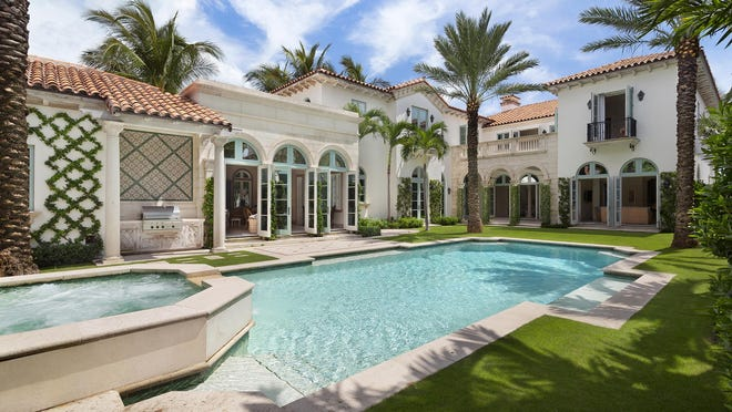 A Mediterranean-style house facing the beach at 516 S. Ocean Blvd. has sold for $24.24 million, the price reported Friday in the local multiple listing service. The house was completed in 2015 as a custom home for Margaret and Christopher Sinclair.
