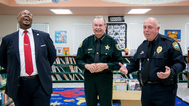 Superintendent Dr. Donald Fennoy, left, laughs, with Palm Beach County Sheriff Ric Bradshaw and School Police Chief Frank Kitzerow as they talk about their experiences during the first day of classes at Jupiter Elementary School Aug. 12.