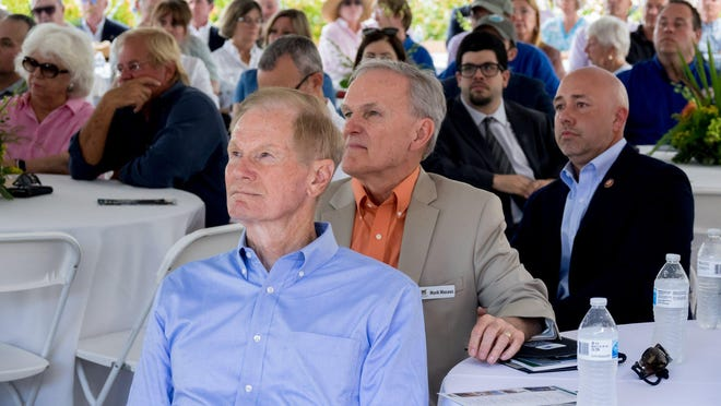 Former Senator Bill Nelson, left, Chief Operating Officer of the National Wildlife Refuge Association Mark Musaus, middle, and Congressman Brian Mast, right listen during the dedication ceremony for the Nathaniel P. Reed Hobe Sound National Wildlife Refuge.