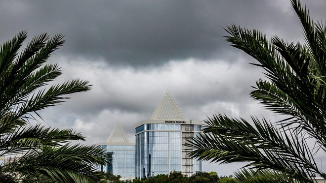 Dark clouds move in quickly as rain passes over the Divosta Towers on PGA Boulevard in Palm Beach Gardens on Oct. 7, 2019.