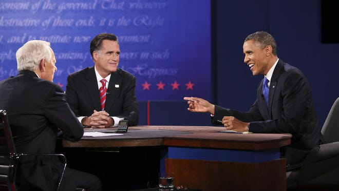 President Barack Obama and Mitt Romney participate in a presidential debate at Lynn University's World Performing Arts Center in October 2012.