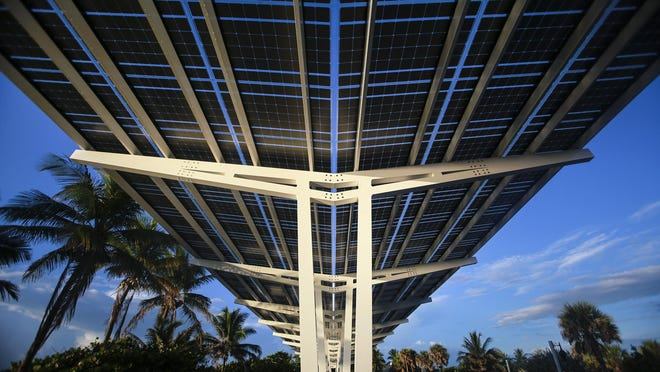 An FPL SolarNow project at Oceanfront Park on Tuesday in Boynton Beach. Supported by voluntary contributions, special solar power installations like this one convert sunshine into clean, emissions-free electricity and deliver it to Florida Power & Light's energy grid.