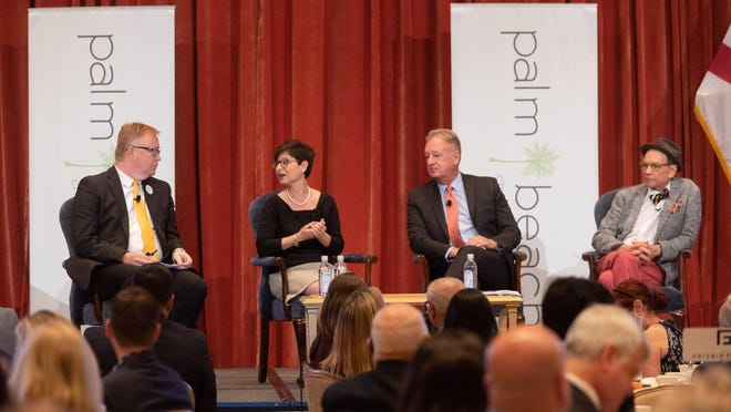 Dave Lawrence, president and chief executive officer of the Cultural Council for Palm Beach County, left, moderated a panel that featured Palm Beach Dramaworks' Sue Ellen Beryl;  Doug Evans of the Chamber Music Society of Palm Beach, second from right; and artist Bruce Helander during a Palm Beach Chamber of Commerce breakfast Thursday at The Breakers.