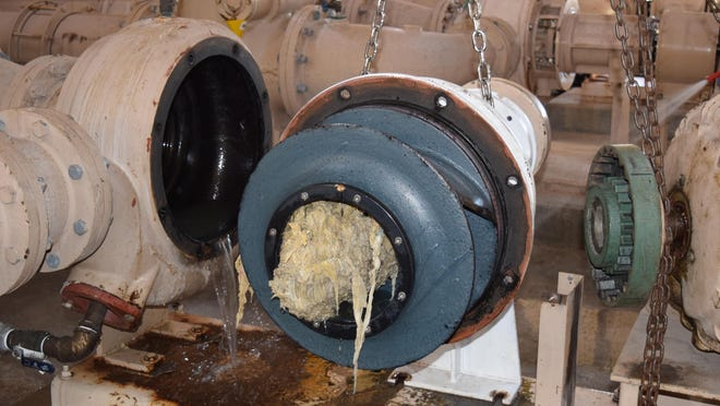 Prior to the coronavirus pandemic reaching the U.S. in force, wipes seen here have clumped together inside a pump at one of Palm Beach County's wastewater pump stations.