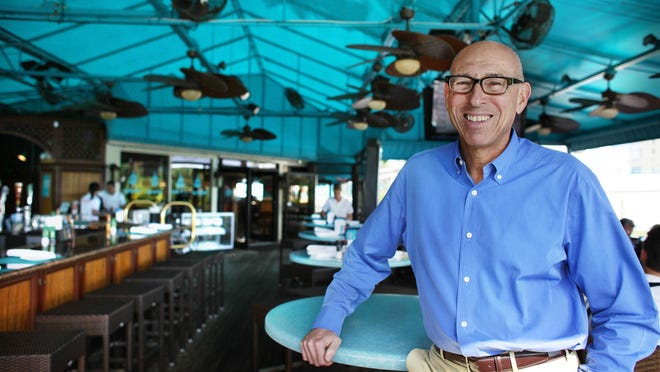 122011 (Alyssa Orr/The Palm Beach Post) Delray Beach-- Burt Rapoport at his casual waterfront dining restaurant, Deck 84, off of East Atlantic Avenue in Delray Beach.  Rapoport is the owner of Rapoport's Restaurant Group, Inc.