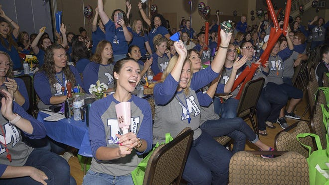Teachers make some noise to compete for the spirit award at the 2019 South Lake Teacher Appreciation Breakfast on Tuesday.