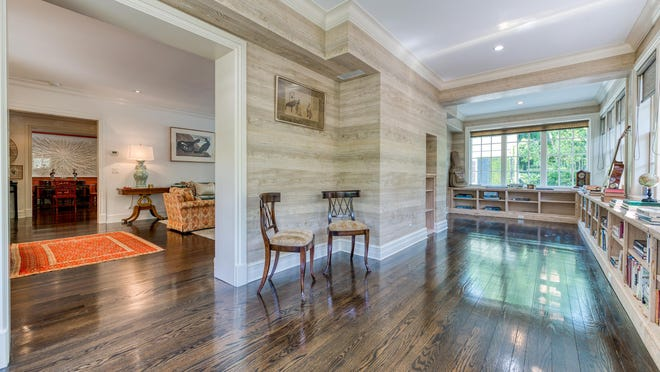 In the enclosed loggia at 345 Seaspray Ave., the walls are covered in a wallpaper that looks like pecky cypress. The 1937s-era house is on the market for $5.989 million.
