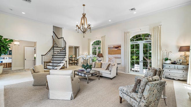 A house at 165 Root Trail in Palm Beach went under contract this week. An open staircase provides a focal point in the living room, whcih has 15-foot ceilings.