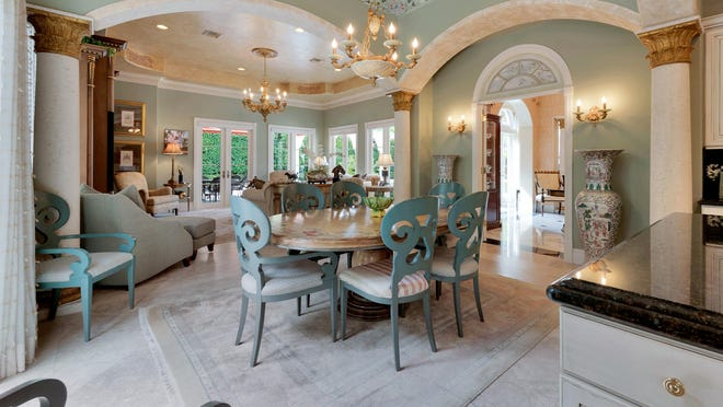 The breakfast area bridges the kitchen and the family room at a Mediterranean-style house at 240 Via Las Brisas, which is listed for sale at $9.847 million.