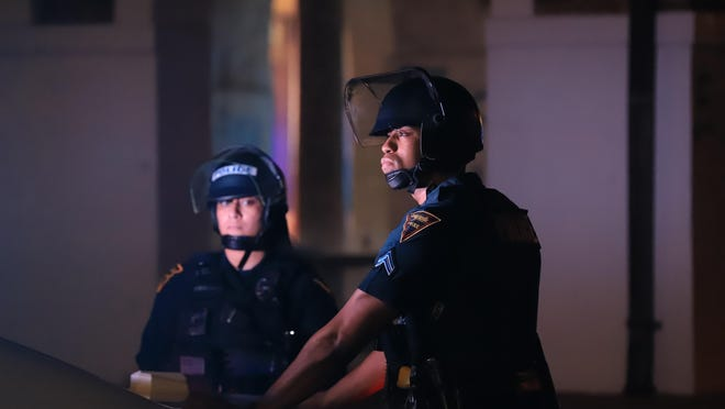 Fayetteville police officers on scene at a protest on May 30, 2020, at the Market House in downtown Fayetteville. Protesters set fires at the Market House that evening. Two men have pleaded guilty in the crime.