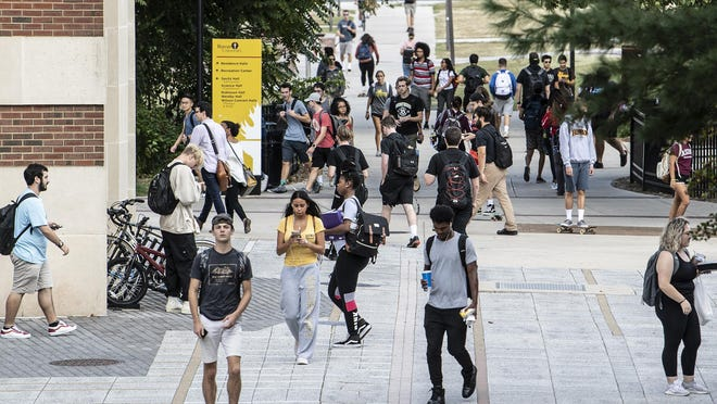 Students walk through campus at Rowan University in Glassboro, N.J. Tuesday, Sept. 24, 2019. Rowan is one of the fastest growing colleges in the country.