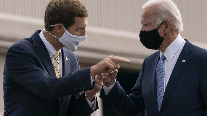 Democratic presidential candidate former Vice President Joe Biden talks with Rep. Conor Lamb, D-Pa., before departing Allegheny County Airport in West Mifflin, Pa., campaign events in Pittsburgh, Pa., Monday, Aug. 31, 2020.