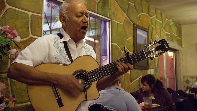 "In this 2010 photo, Manuel ""Cowboy"" Donley performs at  El Gallo restaurant in Austin."