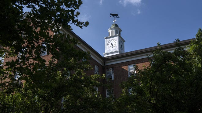 A bobcat weather vane, shaped in the likeness of the university mascot, sits atop an empty residence hall on Ohio University's  campus in Athens, Ohio, on July 8, 2020. Aiming for lower density on campus, the Athens university expects to bring about 7,200 students back to campus in late September, just 31% of OU's normal undergraduate on-campus student population.