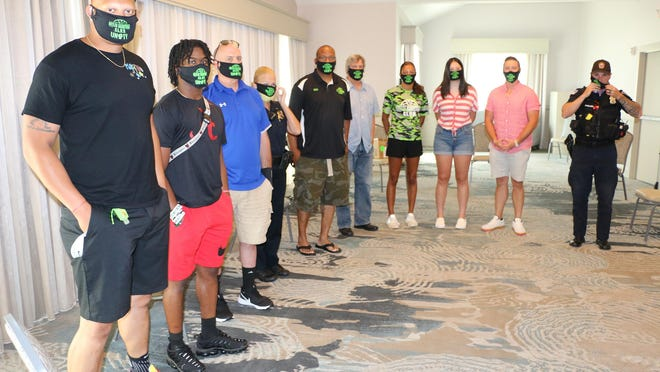 Participants in a discussion that focused on race and community relations with police pose for a photo on Saturday morning at the Howard Johnson's hotel in Middletown.
