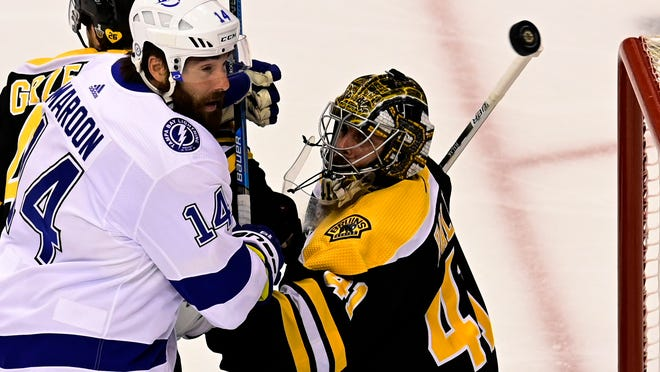 Tampa Bay Lightning left wing Patrick Maroon (14) battles for the puck with Boston Bruins goaltender Jaroslav Halak (41) in front of the net during the first period of an NHL Stanley Cup Eastern Conference playoff hockey game in Toronto, Ontario, Wednesday, Aug. 26, 2020.