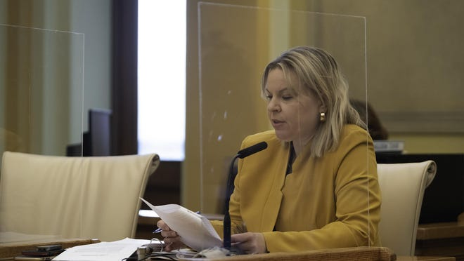 Plexiglass panels used as barriers can be seen as County Attorney Cynthia Mitchell speaks at the Pueblo County Commissioners meeting on Tuesday.
