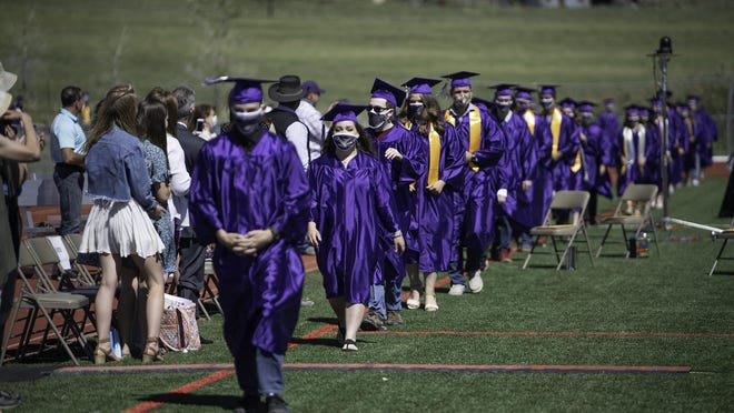 Rye High School graduates-to-be walk to their seats on the field of Thunderbolt Stadium at the start of Thursday's commencement ceremony.