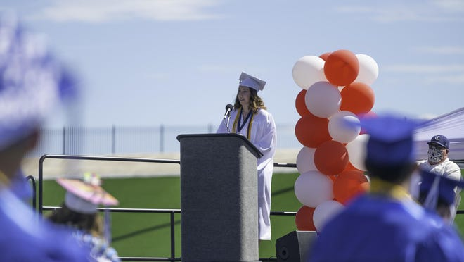 Salutatorian Abigail Gridley offers encouragement to fellow Central High School graduates during Friday's in-person commencement celebration at the Neta and Eddie DeRose ThunderBowl.