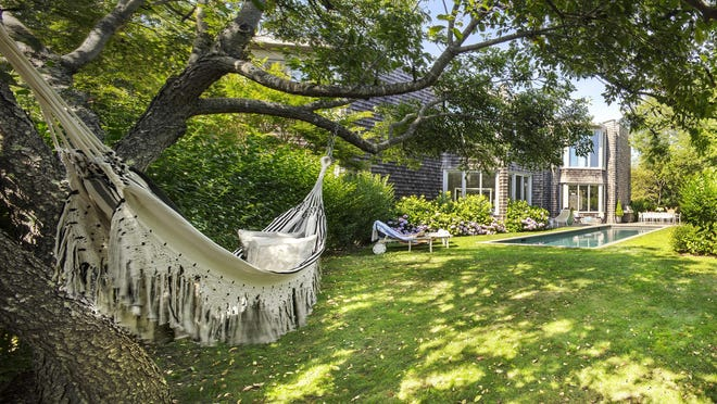 Adding a cozy hammock brings beauty and comfort and can be especially useful if you're staying home for much of this summer.