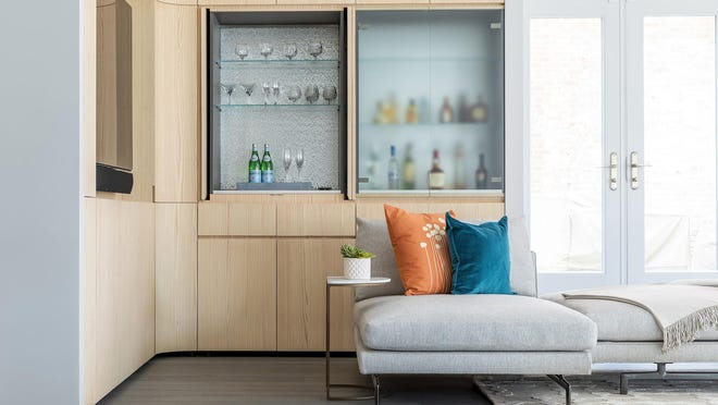 A bar area built into the wall of a modern living space.