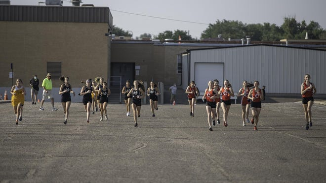 Runners take off from the start at the Pueblo South Tri-Meet on Aug. 21, 2020, at Pueblo South High School.