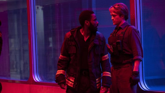 """Tenet""Caption: (L-r) JOHN DAVID WASHINGTON and ROBERT PATTINSON in Warner Bros. Pictures' action epic ""TENET,"" a Warner Bros. Pictures release.Copyright: © 2020 Warner Bros. Entertainment Inc. All Rights Reserved."