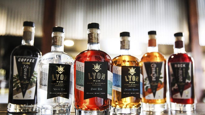 Bottles of alcohol, including Lyon rum, are displayed. Windon Distilling, a Maryland-based producer of Lyon Rum, is among the many craft distillers taking an economic hit from the COVID-19 pandemic. A report released Thursday estimates that craft distillers will see an estimated 41% of their sales - worth more than $700 million - evaporate because of the pandemic.
