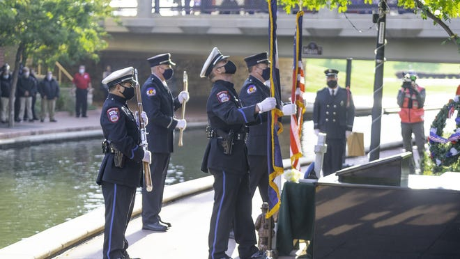 Members of the Pueblo Police and Fire Department Honor Guard post the colors at the start of the 9/11 Memorial, held on the Riverwalk outside the Center for American Values  Friday.