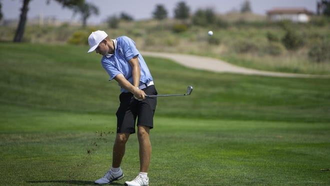 Pueblo West High School's Noah Wagner hits his second shot from the fairway on the 13th hole of the Centennial Invite at Walking Stick Golf Course on Aug. 26.