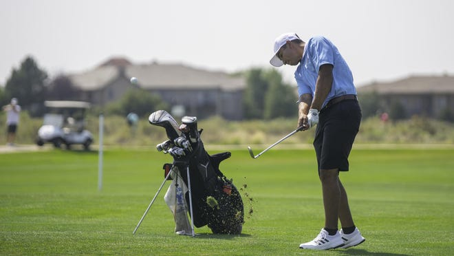 Pueblo West High School's Toby Salinas hit a fairway shot on the 11th hole of the Centennial Invite at Walking Stick on Aug. 26.