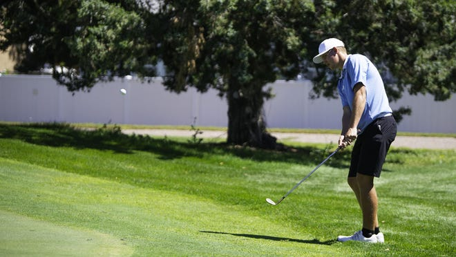 Pueblo West High School's Noah Wagner chips in for birdie on the 13th hole of the South Invitational at Elmwood Golf Course on Wednesday.