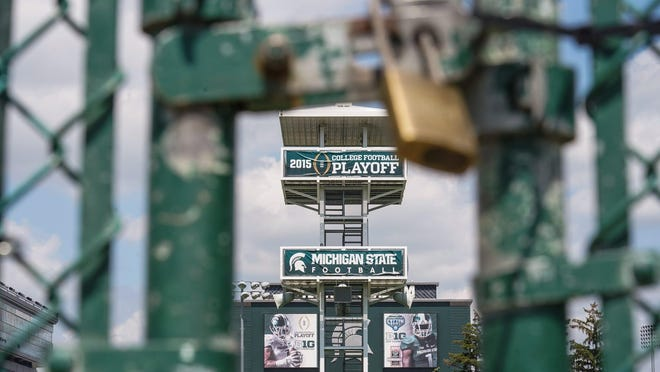 A locked section of fencing around the Michigan State football practice field Monday on campus in East Lansing, Mich. The Big Ten Conference canceled the 2020 college football season in a historic move that stems from concerns related to the ongoing coronavirus pandemic.