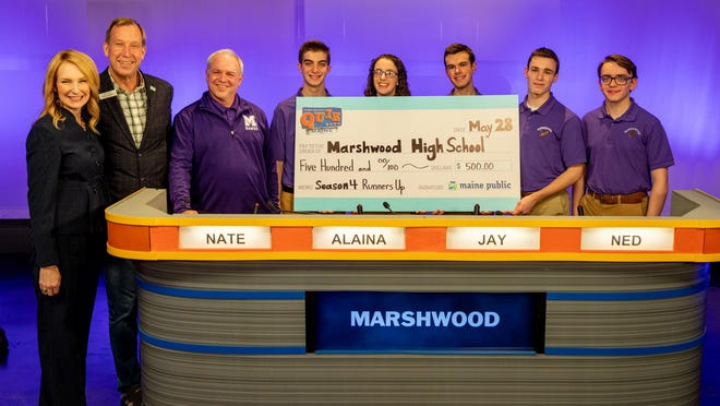 Marshwood High School's team in the 2020 Maine High School Quiz Show consisted of junior Owen Byrne, senior Nate Reppucci, senior Alaina Smith, senior Jay Whitesell, and junior Ned Whitesell. They were coached by David Lietz. They are pictured with host Shannon Moss and Maine Public President and CEO Mark Vogelzang.
