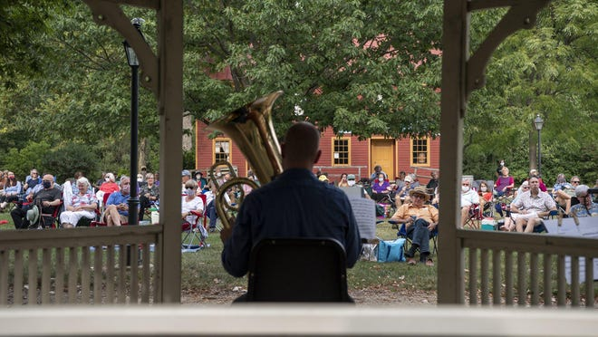 About 150 concert-goers attend a sold-out production by members of the ProMusica Chamber Orchestra in the town square of the Ohio History Connection's Ohio Village on Sept. 1. The audience was treated to an evening of music by a horn quintet and strings.