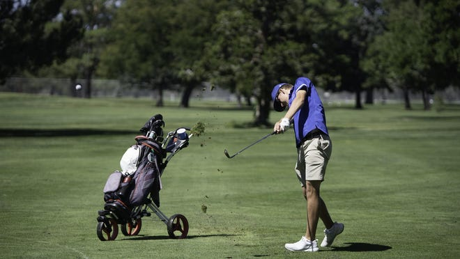 Keaton Murphy of Swallows Charter Academy hits his second shot from the fairway on the 13th hole of the South Invitational at Elmwood Golf Course earlier this season. Murphy is the individual 2020 Class 3A Santa Fe League Champion.