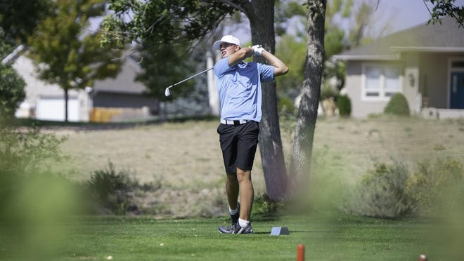 Pueblo West High School's Noah Wagner watches his tee shot on the 14th hole during the Class 4A Region 1 boys golf tournament at Desert Hawk Golf Course on Monday.