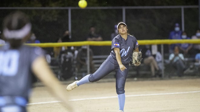 Pueblo West High School's Jaycee Montes-Duran throws for an out at first base after fielding the ball at third during the Cyclones' matchup with Central on Sept. 15 at Salas Field.