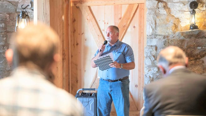 Bill Zwick, capital projects manager for the city of Pueblo, speaks at the 'ribbon-cutting' ceremony at the restored Goodnight Barn Friday.