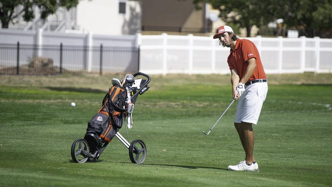 Centennial High School's Rick Lane chips onto the green from the fairway of the 12th hole at Desert Hawk Golf Course during the Class 4A Region 1 boys golf tournament on Sept. 21.