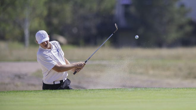 Pueblo West High School's Noah Wagner hits his third shot from a bunker on the second hole of the Class 4A state high school boys golf championships at the Country Club of Colorado on Monday.
